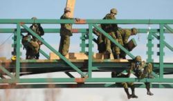 military placing decking on Blindman River bridge